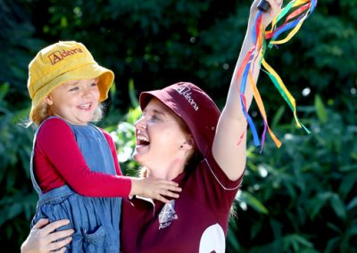 Mitchelton childcare worker celebrating with child