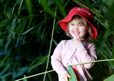 happy child in the trees at mitchelton childcare